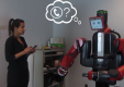 Playing the 'Trust Game' with Robots: Social Strategies and Experiences (2015)