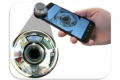 Surround-See: Enabling Peripheral Vision on Smartphones during Active Use