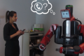 Playing the 'Trust Game' with Robots: Social Strategies and Experiences